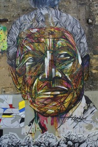 French-graffiti-artist-Hopare-paints-a-street-art-mural-of-Nelson-Mandela-in-an-artistic-graphic-style